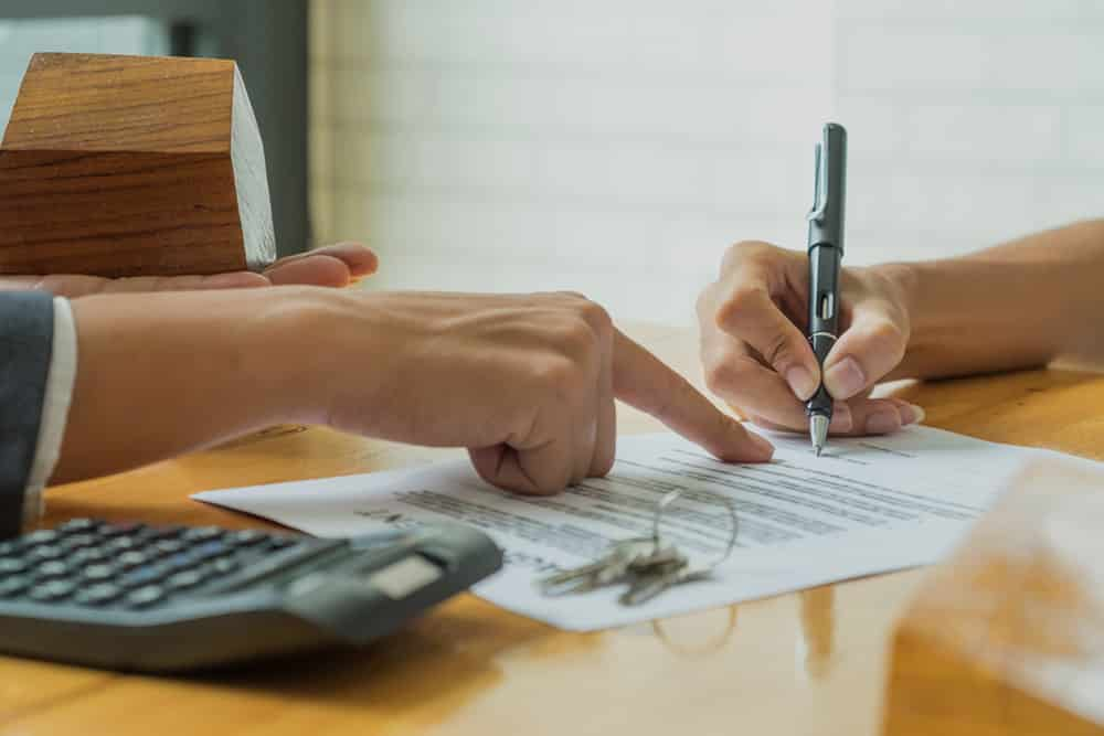 Person Signing rental agreements