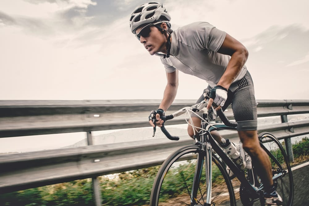 Cyclist riding on road