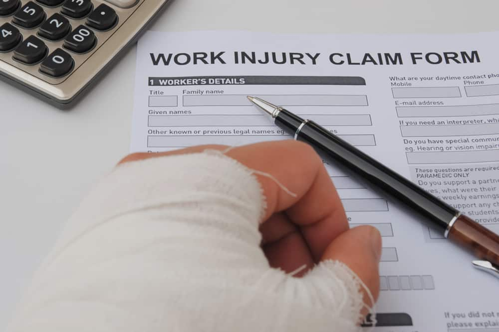 Injured Worker signing Work Injury Claim Form