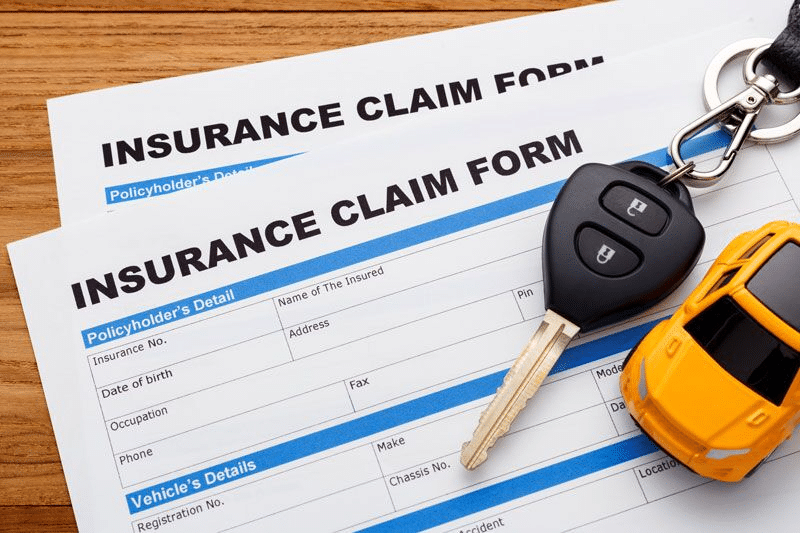 car insurance claim form with car keys, securing the right amount of car coverage