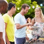 man grilling at party, grill safely this Memorial Day