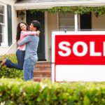 could embracing in front of their new home; save on your first home policy