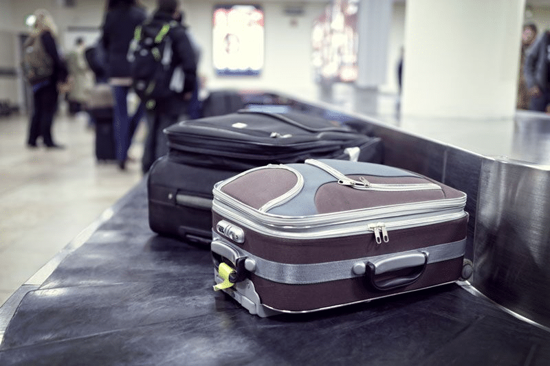 luggage in baggage claim; keep your staff safe as they travel