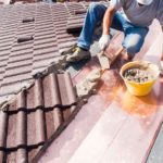 man repairing roof, how to prevent common home insurance claims