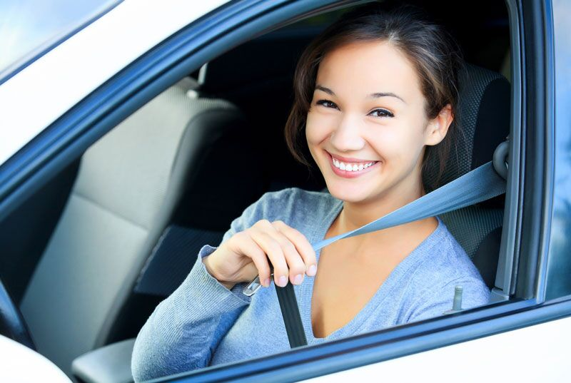 young driver buckling up, can unlock auto insurance discounts when you turn 21