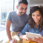 couple on tablet, what to do when changing auto insurance providers