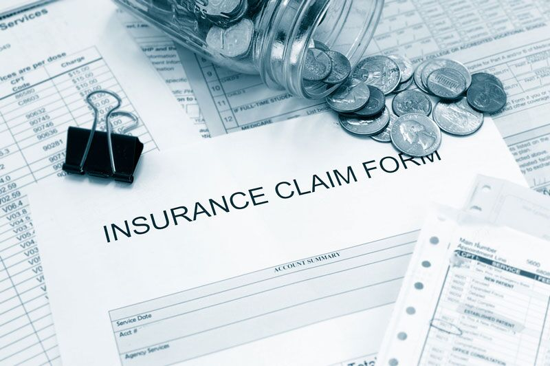 insurance claims form surrounded by coins, most expensive home insurance claims