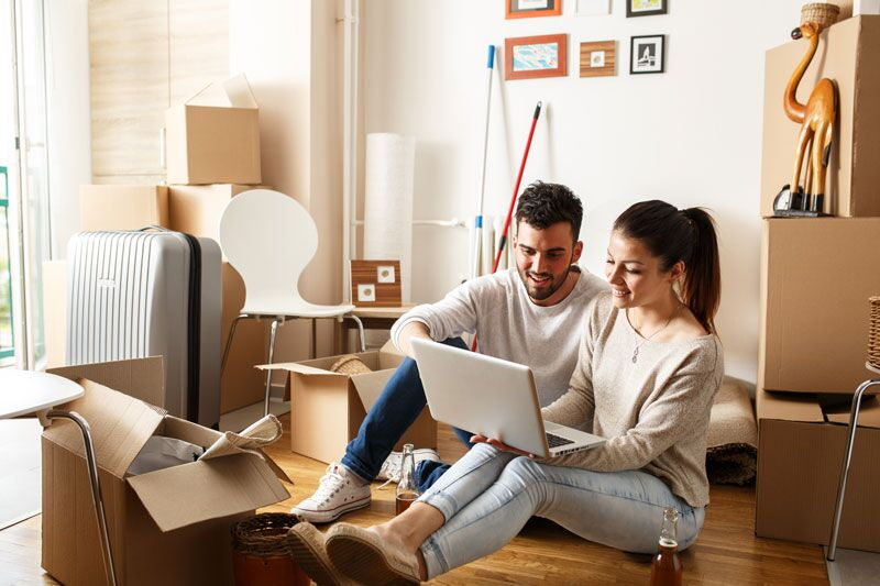renters on a laptop, importance of renters insurance