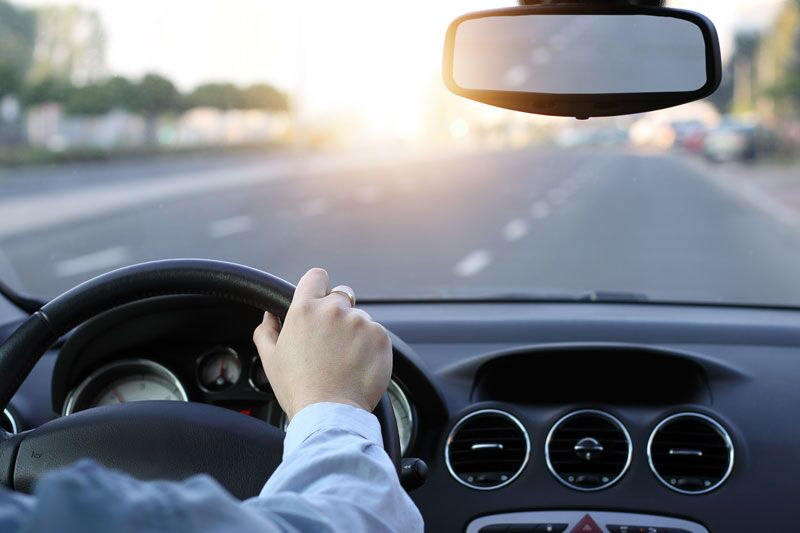 man driving, money-saving tips for drivers